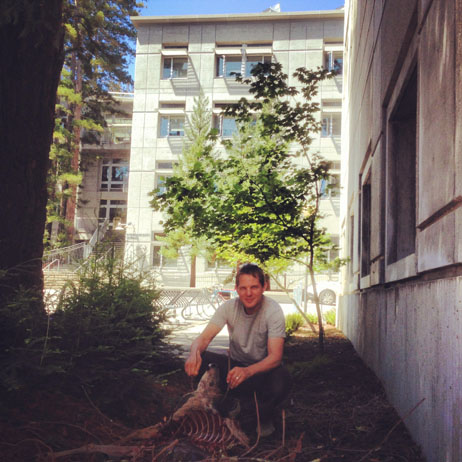Chris posing with 36M's kill in front of the ISB building at UCSC